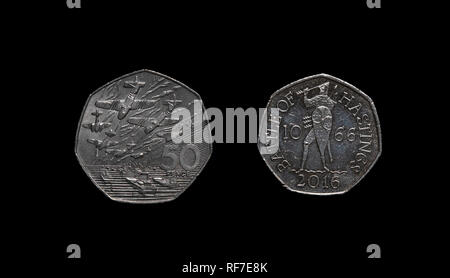 UK commemorative 50 pence coins celebrating the two invasions that are part of UK history. - Stock Image