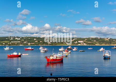 Seascape with sea harbor with clear blue water and traditional colorful greek fisher boats in sunny day - Stock Image