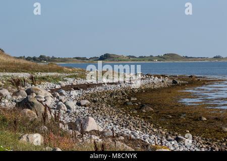 Rocky coastline on the northwest Sejrø - Stock Image