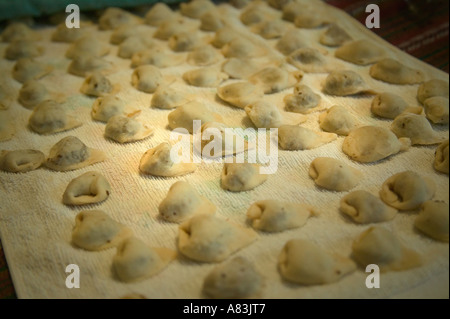 'Wushka' laid out on a sheet immediately after being rolled. - Stock Image