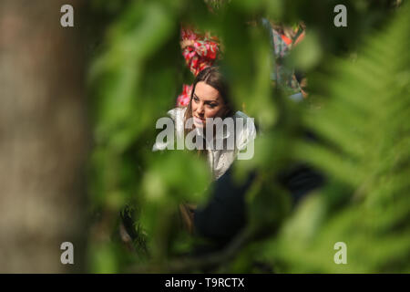 Duchess of Cambridge looks at a display during her visit to the RHS Chelsea Flower Show at the Royal Hospital Chelsea, London. - Stock Image