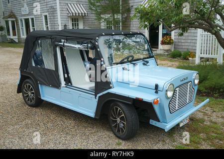Blue Mini Moke electric car with a black Bimini top. - Stock Image