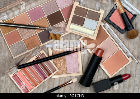 Selection of cosmetics and makeup. Cosmetics are substances or products used to enhance or alter the appearance of the face and body. - Stock Image