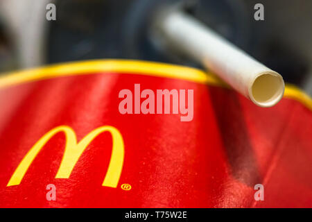 Mcdonalds paper straws recently replaced plastic at their UK stores to combat plastic polution following a petition by sumofus. - Stock Image