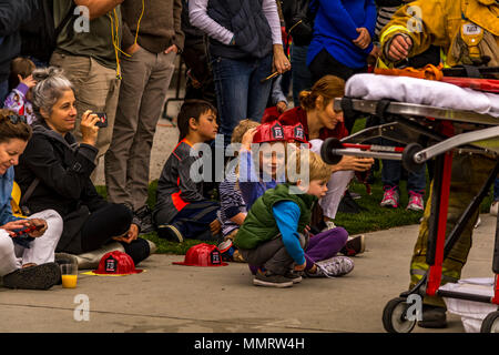 Los Angeles, California, USA 12 May 2018 People watching Los Angeles City Firefighters from Truck 27 in Hollywood doing a demo of a resuce using a rescue tool on Fire Service Day. Credit: Chester Brown/Alamy Live News. - Stock Image