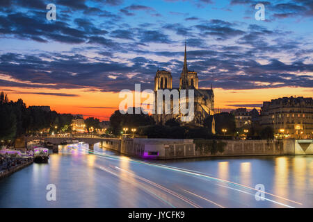 View of the Paris church notre dame at sunset - Stock Image