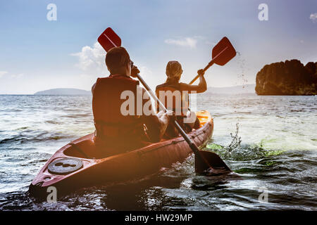 Man and woman kayaking in sea - Stock Image