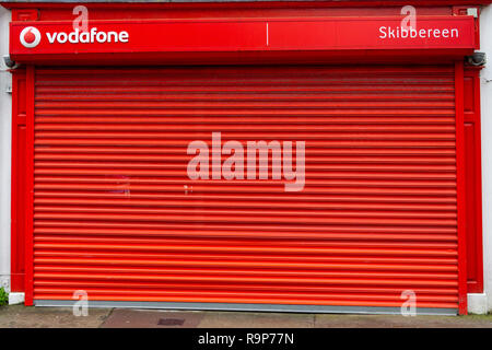 Vodafone shop shut with metal shutters down - Stock Image