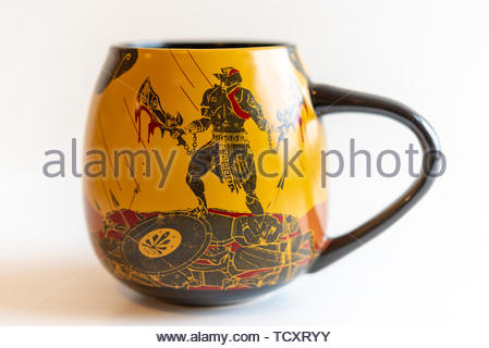 'God of War' exclusive collectible drinking mug. God of War is an action-adventure video game developed by Santa Monica Studio. It was published by So - Stock Image