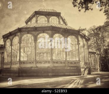 A retro effect image of The Palacio de Cristal (Crystal Palace) in Buen Retiro Park, Madrid, Spain. A must see location for tourists visiting Madrid. Photo © COLIN HOSKINS. - Stock Image