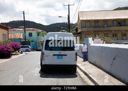 Taxi parked in a fishing village in St Lucia, The Caribbean - Stock Image
