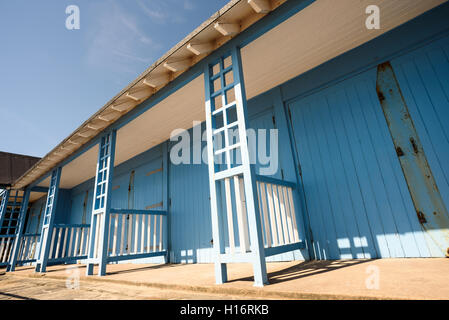 Wooden beach hut popular with beachgoers painted in light blue wood in sunshine. Nobody in the summer scene. - Stock Image