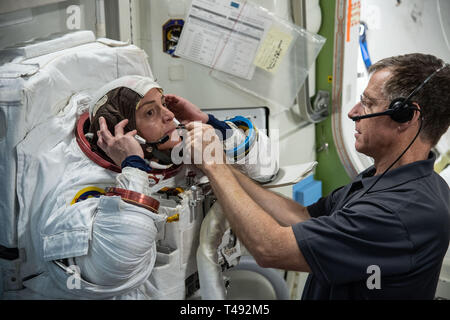 Commercial Crew Program astronaut Nicole Mann, left, is assisted with her spacesuit by Boeing astronaut Chris Ferguson during Quest Airlock simulation for ISS EVA training in preparation for future spacewalks while onboard the International Space Station at the Johnson Space Center February 6, 2019 in Houston, Texas. - Stock Image
