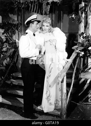 John Wayne and Marlene Dietrich / Seven Sinners / 1940 directed by Tay Garnett (Universal Pictures) - Stock Image