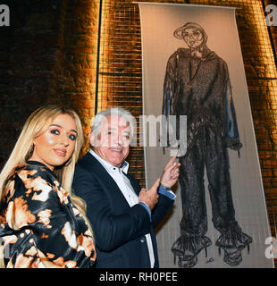 Manchester, UK. 31st January, 2019. Morgan Allen MMU studennt shows Kevin Keegan the mural she created and on display at the launch of The Yard Stangeways Credit: Della Batchelor/Alamy Live News - Stock Image