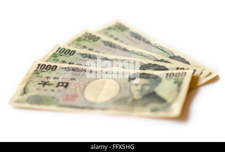 1000 yen notes on a white background. - Stock Image