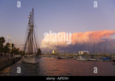 Barcelona Port Vell sunset Santa Eulalia sailing boat, - Stock Image