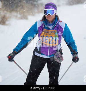 A woman competes in the Mora Vasaloppet ski race on February 10, 2013 in Mora, Minnesota. - Stock Image