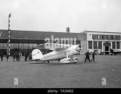 The record airplane of the American pilot Wiley Post, a Lockhhed Vega with the registration number NR105W and the christening name 'Winnie Mae of Oklahoma' at the airport Berlin-Tempelhof. - Stock Image
