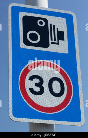 Combined 30 mph speed limit and traffic enforcement camera sign UK - Stock Image