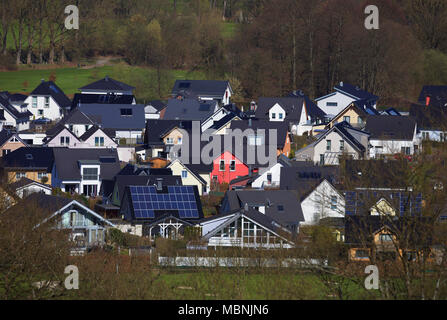 red house in centre of rural village - Stock Image