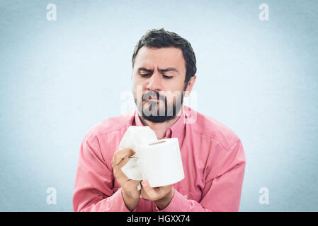Young Man with Toilet Paper Isolated on the White Background - Stock Image