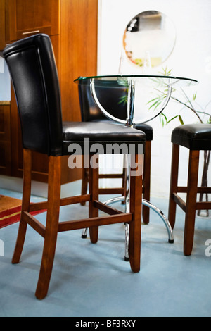 Chairs in a dining room - Stock Image