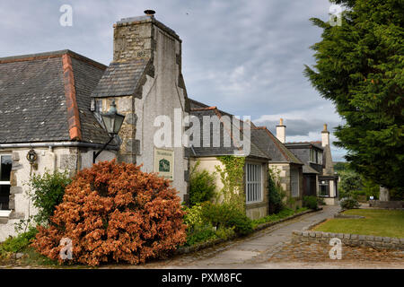 The Lairhillock Inn classic Scottish Inn near Aberdeen Scotland UK with red Lena Scotch broom bush in June - Stock Image