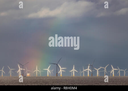 Offshore wind turbines and rainbow, Colwyn Bay, North Wales coast - Stock Image