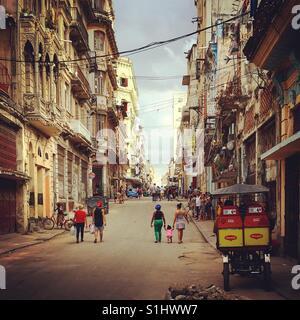 Havana street with locals walking through old Havana in Cuba - Stock Image
