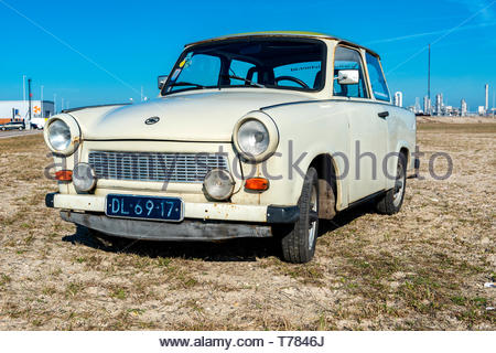 Rotterdam, Netherlands. A DDR build, vintage Trabant (1971) or Trabi driving around the Port of Rotterdam Harbor area on a sunny day. - Stock Image
