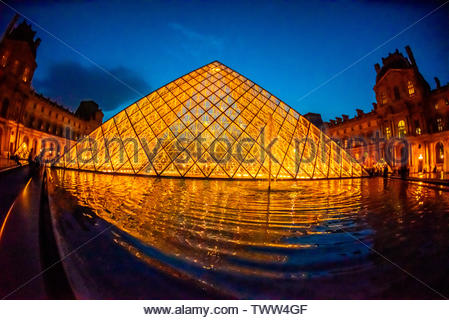 The Louvre Pyramid (Pyramide du Louvre) is a large glass and metal pyramid designed by Chinese-American architect I. M. Pei, surrounded by three small - Stock Image