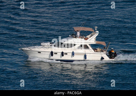Princess 410 motor yacht with dinghy fore and jetski aft - Stock Image