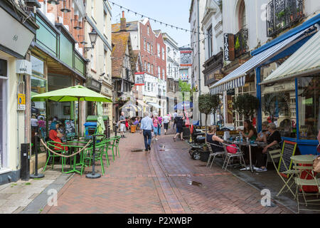 People eating and drinking in the terraces in George street at Hastings old town, East Sussex, England , UK - Stock Image