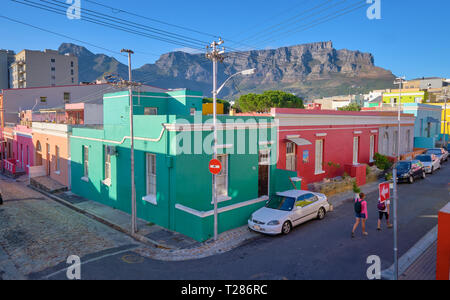 View from higher of colorful houses and streets of Bo Kaap, with Table Mountain in background. Cape Town, South Africa, March 21, 2019. - Stock Image