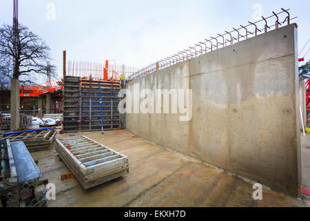 Poured concrete reinforced walls on building site. - Stock Image