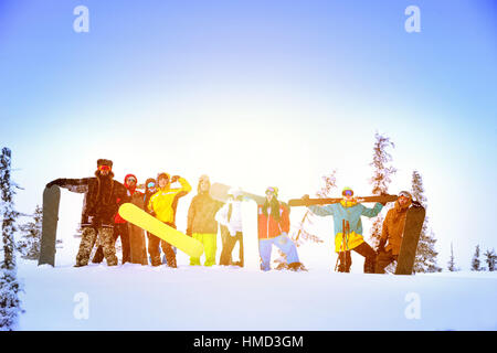 Group friends skiing snowboarding resort - Stock Image