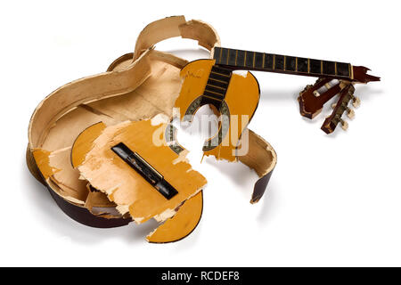 A smashed and broken acoustic guitar - Stock Image