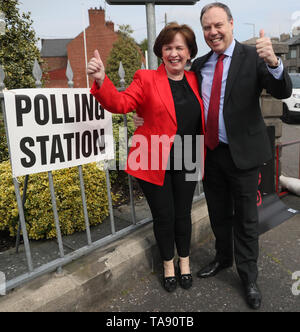 Sitting MEP Diane Dodds, with husband Nigel Dodds, arrives at Bannside Presbyterian Church in Banbridge to cast her vote for the European Parliament election. - Stock Image
