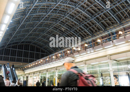 King's Cross station, passengers waiting for trains on the platform - Stock Image