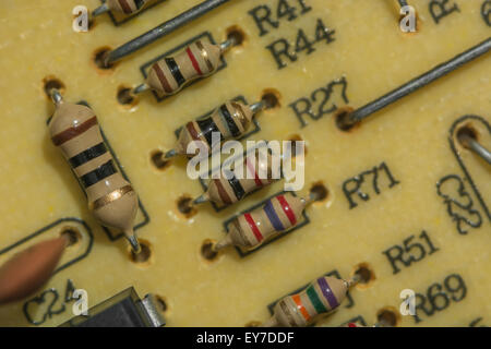 Macro-photo of carbon resistors on a printed circuit board (PCB). - Stock Image