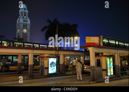 Tsim Sha Tsui bus station and clock tower, Hongkong CN - Stock Image