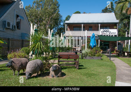 Life-sized sheep replicas draw daytrippers to a local business in Samford, a hill country village outside Brisbane, Queensland, Australia - Stock Image