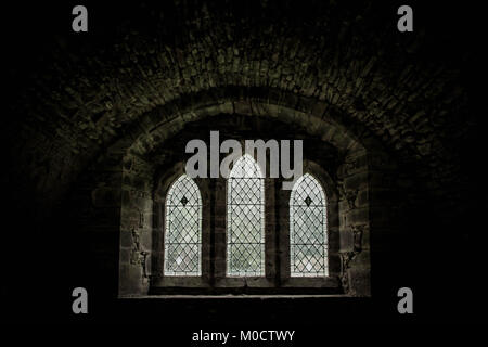 small  tryptych chaple window - Stock Image