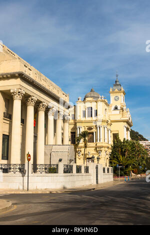 Malaga Spain. National central Bank of Spain building with town hall behind, Malaga, Andalusia, Spain. - Stock Image