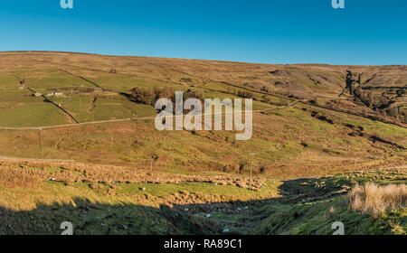 North Pennines AONB panoramic landscape, view over the Hudes Hope valley, Teesdale, UK in strong winter sunshine and a clear blue sky - Stock Image