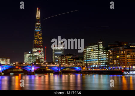 The Shard, the River Thames and Southwark Bridge seen from Millenium Bridge on a Winter night. - Stock Image