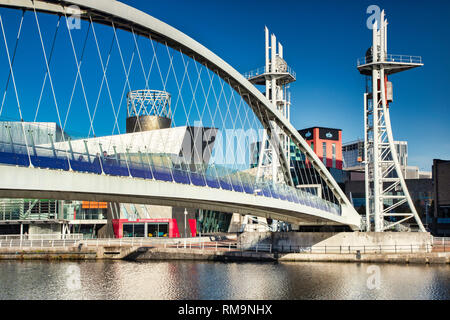 2 November 2018: Salford Quays, Manchester, UK - The Lowry Bridge on a lovely sunny autumn day, with clear blue sky. - Stock Image