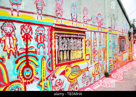 TAICHUNG, TAIWAN - JUL 11: Colorful graffiti dots the walls of the famous Rainbow Village in Taichung, Taiwan. The village has become a must-see attra - Stock Image