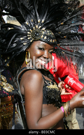 Young Caribbean Girl Dancing in the Notting Hill Carnival Parade 2009 - Stock Image